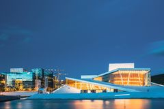 Oslo Norway. Evening View Of Illuminated Opera Ballet House Among High-Rise Buildings Under Blue Sky stock photo