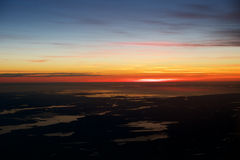 OSLO, NORWAY - JAN 21st, 2017: View off the sunrise, norway during winter from inside the plane during my Lufthansa Royalty Free Stock Photo