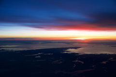 OSLO, NORWAY - JAN 21st, 2017: View off the sunrise, norway during winter from inside the plane during my Lufthansa Royalty Free Stock Photography