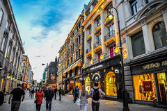 OSLO, NORWAY: People walking around in Karl Johans Gate, the famous street of Oslo in the evening Royalty Free Stock Photography