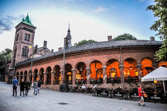 OSLO, NORWAY: People walking around in Karl Johans Gate, the fmous street of Oslo in the evening Stock Photo