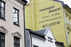 Ferdinand Larsen. Oslo, Norway - June 20, 2019: Building detail of the building located at 26 Torggata street with advertising for Ferdinand Larsenm painted on stock images