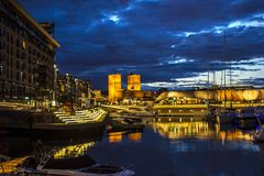Oslo harbour at night, Norway. Oslo, Norway - June 26, 2018: Oslo harbour at night, with Aker Brygge and Bjorvika, the main shopping districts of the City of stock images