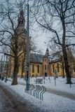 OSLO, NORWAY - MARCH, 26, 2018: Outdoor view of Domkirke Cathedral in Oslo with some dry trees in front at Oslo. Norway stock images