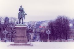 OSLO, NORWAY - MARCH, 26, 2018: Outdoor view of Statue of King Karl Johan outside The Royal Palace in Oslo. In Norway, vintage effect Stock Photography