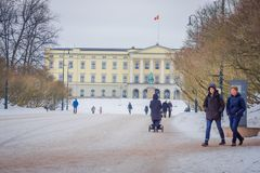 OSLO, NORWAY - MARCH, 26, 2018: Outdoor view of unidentified people walking in front of the Royal Palace, was built in. The first half of the 19th century in Stock Photo