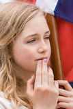 Oslo, Norway - May 17, 2010: National day in Norway. Norwegian girl at traditional celebration and parade on Karl Johans Gate street Stock Photography