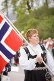 Oslo, Norway - May 17, 2010: National day in Norway. Norwegian woman in the national costume at traditional celebration and parade on Karl Johans Gate street Royalty Free Stock Image