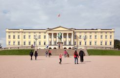 Oslo royal palace. Oslo, Norway - September 16, 2016: View of the Oslo royal palace exterior  with people walking Royalty Free Stock Images