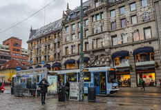 Oslo street view before the Christmas. People and a streetcar stop in Oslo, Norway in December 2013 Stock Image
