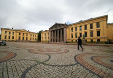 Oslo university. The building of Oslo University, Norway, wide angle perspective, a man walking, motion blurred Royalty Free Stock Image