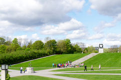 Oslo Vigeland Park with Tourists. OSLO, NORWAY - SEPTEMBER 7: Statues in Vigeland park in Oslo, Norway on September 7, 2012.The park covers 80 acres and features Stock Image