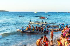 OSLOB, CEBU - FEBRUARY 23, 2018: A group of tourists near the shore is going to sail in boats. Copy space for text royalty free stock photos