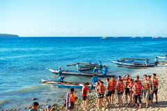 OSLOB, CEBU - FEBRUARY 23, 2018: A group of tourists near the shore is going to sail in boats. Copy space for text stock photo