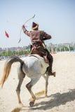 Osmanereiterbogenschützereiten und -schießen stockfoto