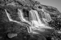 Osmington Mills waterfall. A long exposure of a natural waterfall at Osmington Mills flowing into the sea Royalty Free Stock Photo
