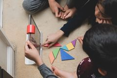 Leicester, Leicestershire, United Kingdom. 22 February 2019. School age kids learning and enjoying on Osmo, a platform using iPads. Osmo is a line of royalty free stock image