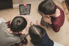 Leicester, Leicestershire, United Kingdom. 22 February 2019. School age kids learning and enjoying on Osmo, a platform using iPads. Osmo is a line of stock image