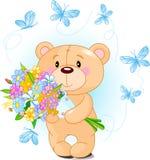 Oso azul del peluche con las flores Foto de archivo