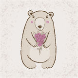 Oso con las flores Imagen de archivo libre de regalías