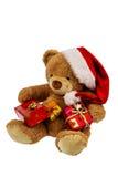 Oso de peluche con los regalos de la Navidad Fotos de archivo libres de regalías