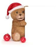 Oso de peluche con un panel de la Navidad Imagenes de archivo