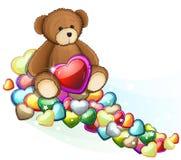 Oso de peluche de Brown con los corazones de la tarjeta del día de San Valentín Foto de archivo libre de regalías