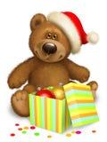 Oso de peluche de la Navidad con la caja Imágenes de archivo libres de regalías