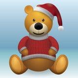 Oso de peluche en sombrero rojo del rojo del suéter Foto de archivo libre de regalías