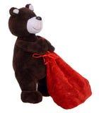 Oso de peluche que lleva el bolso con los regalos Fotos de archivo libres de regalías