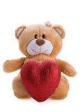 Oso del peluche que lleva a cabo un corazón Foto de archivo libre de regalías