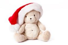 Oso del peluche y casquillo de Navidad foto de archivo