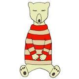 Oso el dormir en un suéter hecho punto Fotos de archivo