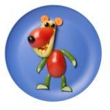 Oso graciosamente compilado de diversas verduras en la placa azul Imagen de archivo