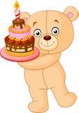 Oso que sostiene la torta de cumpleaños Imagen de archivo