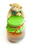 Oso y miel del peluche Imagen de archivo