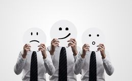 Osob smilies w rękach Zdjęcie Stock
