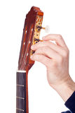 Osoba nastraja gitarę od swój headstock Zdjęcia Stock