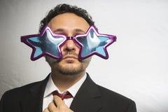 Osobistość, biznesmen z szkło gwiazd, szalonego i śmiesznego achie, Zdjęcie Stock