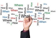 Osoby writing pytania na białej desce Fotografia Stock
