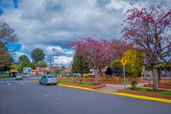OSORNO, CHILE, SEPTEMBER, 23, 2018: Outdoor view of park of dowtown with some trees in a cloudy day with some cars. Circulating in the streets in Puerto Octay stock photos