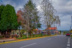 OSORNO, CHILE, SEPTEMBER, 23, 2018: Outdoor view of park of dowtown with some trees in a cloudy day with some cars. Circulating in the streets in Puerto Octay stock images