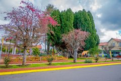 OSORNO, CHILE, SEPTEMBER, 23, 2018: Outdoor view of park of dowtown with some trees in a cloudy day in Puerto Octay. Chile stock photos