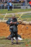 Osovets battle reenactment. A soldier loads a gun. Royalty Free Stock Photography