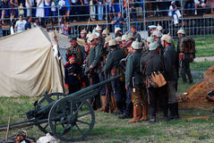 Osovets battle reenactment. Soldiers gathered by a cannon. Royalty Free Stock Photography