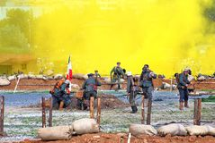 Osovets battle reenactment. Soldiers run in yellow fume. Royalty Free Stock Photo