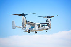 Osprey. The military Osprey taking off.  The wings fold up so that the plane can take off and land like a helicopter and then fold down forward for flight Royalty Free Stock Photo
