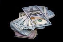 Oss dollar som isoleras på svart Royaltyfri Fotografi
