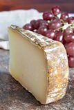 Ossau-Iraty or Esquirrou sheep cheese produced in south-western France, Northern Basque Country. Piece of tasty Ossau-Iraty or Esquirrou sheep cheese produced in royalty free stock photography