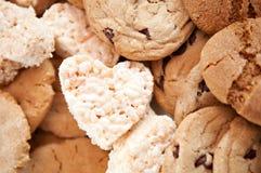 Ossequio & biscotti a forma di cuore Immagine Stock
